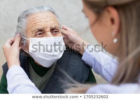 Oude patiënt thuiszorg verpleegkundige glimlach man Stockfoto © AndreyPopov