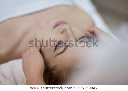 Young Beautiful Woman Getting Back Massage Сток-фото © dotshock