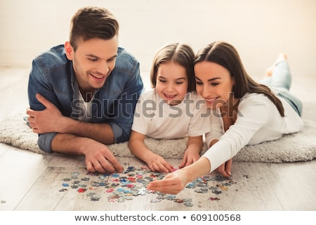 mother and daughter doing a jigsaw puzzle stock photo © photography33