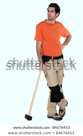Thoughtful laborer with mallet, studio shot Stock photo © photography33