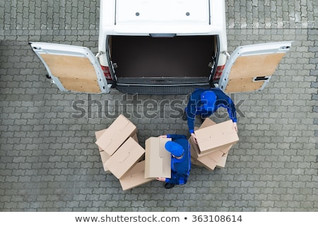 Delivery man carrying stack of cardboard packages stock photo © wavebreak_media