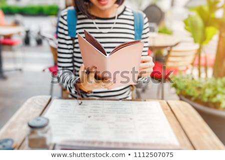 Girls holding a Restaurant Menu Stock photo © lenm