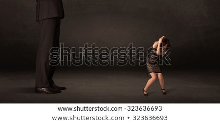 huge man with small businesswoman standing at front concept stock photo © ra2studio