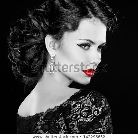 Fashion style portriat of an alluring lady Stock photo © konradbak