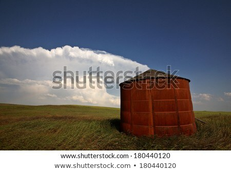 Wooden granary with Cumuloninumbus clouds in background Stock photo © pictureguy