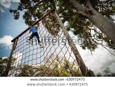 Geschikt vrouw klimmen touw opleiding Stockfoto © wavebreak_media