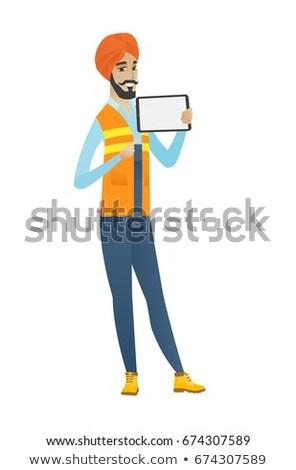 Young hindu builder holding tablet computer. Stock photo © RAStudio