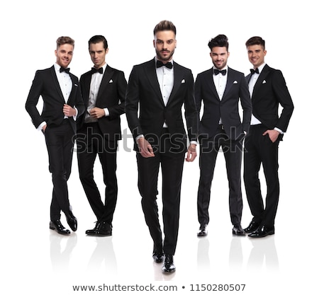 smiling young man in tuxedo and bow tie is walking  Stock photo © feedough