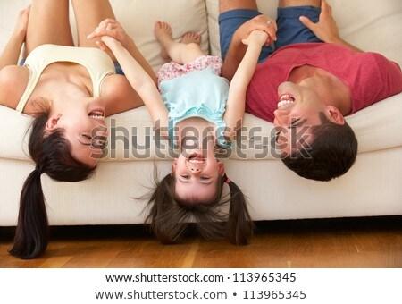 Família de cabeça para baixo sofá casa criança quarto Foto stock © Lopolo
