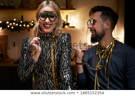 Stock photo: couple with christmas or new year party props