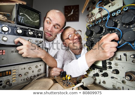 Funny nerd scientist soldering at vintage laboratory Stock photo © nomadsoul1