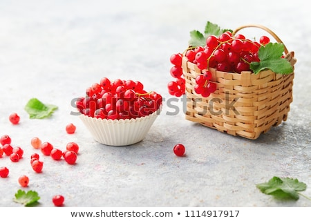 Redcurrant in wicker bowl on the table Stock photo © dmitry_rukhlenko