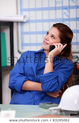 female worker in blue overalls on the office phone stock photo © photography33