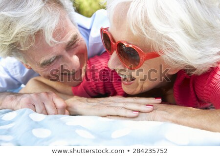 Couple having a cuddle in the countryside Stock photo © photography33