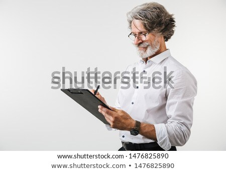 A portrait of a mature businessman taking notes. Stock photo © photography33