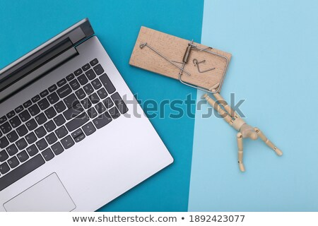 Wooden figurine caught in the mouse trap Stock photo © wavebreak_media