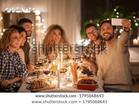 boldog · pár · iszik · vörösbor · karácsony · vacsora - stock fotó © dolgachov