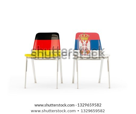 Two chairs with flags of Germany and serbia Stock photo © MikhailMishchenko