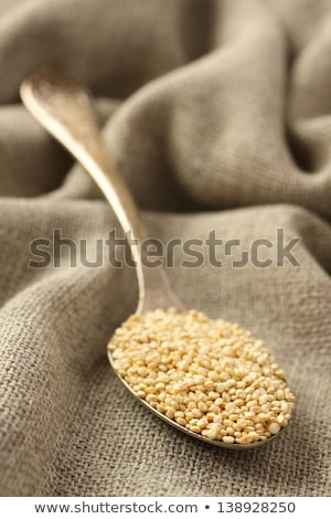 Quinoa grain in metal spoon on sackcloth background Stock photo © Melnyk