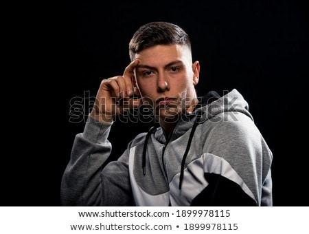 Serious cute male student wearing student clothes expressing emo Stock photo © Blue_daemon