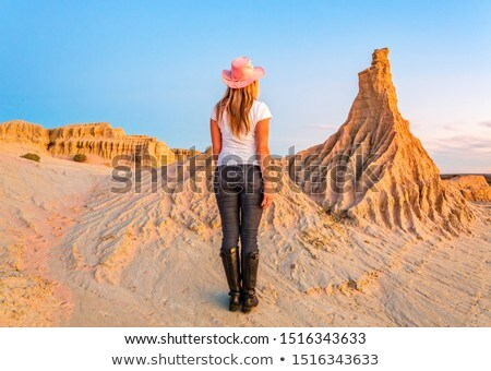 Female walking among the lunette of Mungo National Park Stock photo © lovleah