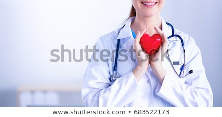 beautiful smiling woman holding red heart stock photo © dolgachov