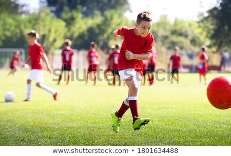 Young Soccer Players Competition. Boys Kicking Football Ball Stock photo © matimix