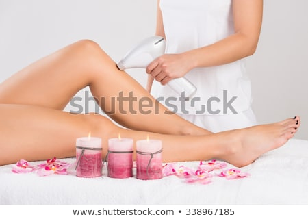 Laser hair removal therapy on a leg of woman customer Stock photo © Kzenon