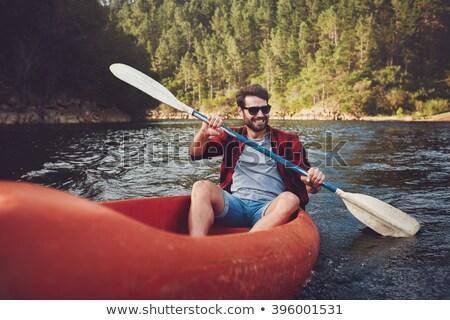 sonriendo · hombre · remo · kayak · retrato · lago - foto stock © photography33