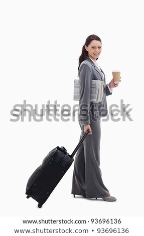 Profile of a businesswoman with a suitcase, a newspaper and a coffee against white background stock photo © wavebreak_media