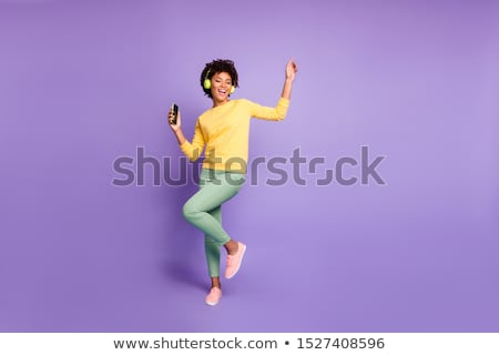 Full body of a female relaxing with music Stock photo © dash
