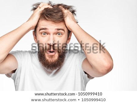 fashion man holding his hand to his mouth stock photo © feedough