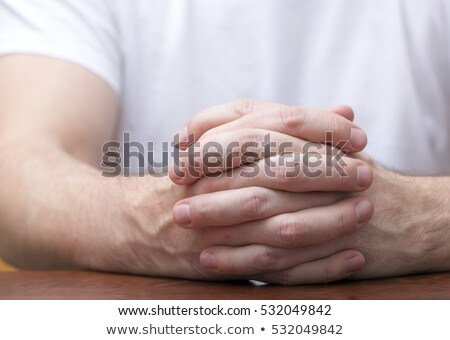 young business man holding his hands crossed stock photo © feedough