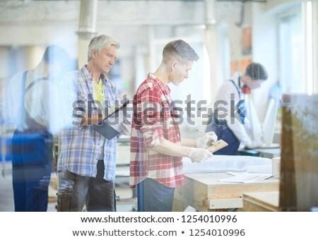 Handyman analyzing while holding clipboard Stock photo © wavebreak_media