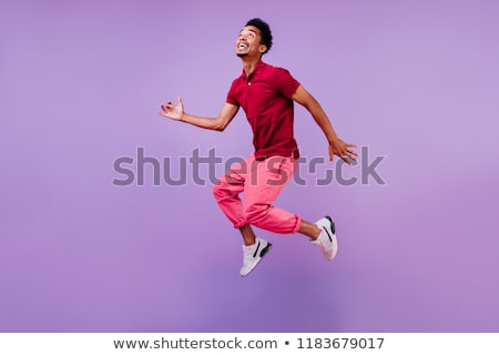 portre · genç · atlama · hava · genç · adam - stok fotoğraf © zurijeta