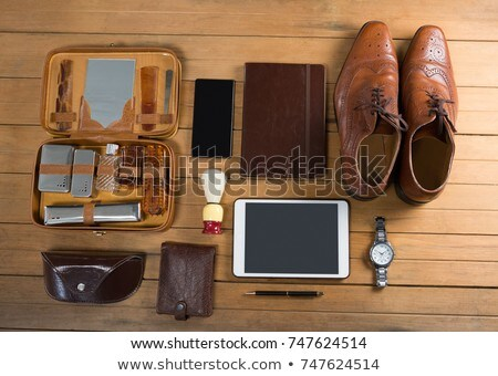 Perfumes and mobile phone arranged on wooden plank Stock photo © wavebreak_media