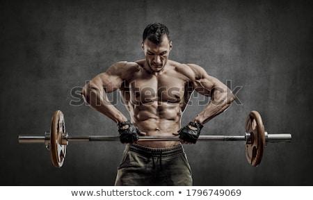 Férfi testmozgás súlyok tornaterem energia fürdő Stock fotó © IS2