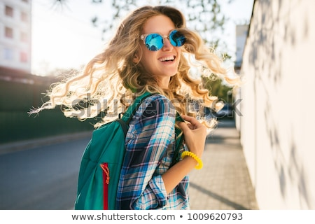 a young woman with a trendy backpack stock photo © studiostoks