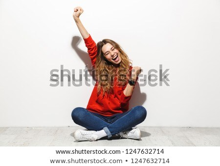 Portrait of happy woman 20s wearing sweatshirt laughing while ta Stock photo © deandrobot