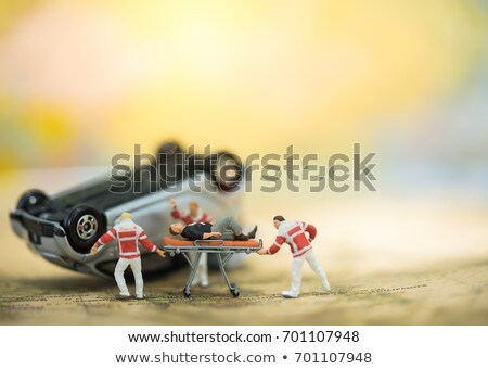 Doctor's Hand Examining Miniature Car Stock photo © AndreyPopov