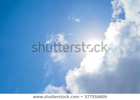 Big white cloud and light ray behind cloud with blue sky Stock photo © galitskaya