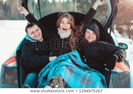 Best female friends cheering by car road trip at sunset. Happy p Stock photo © dashapetrenko