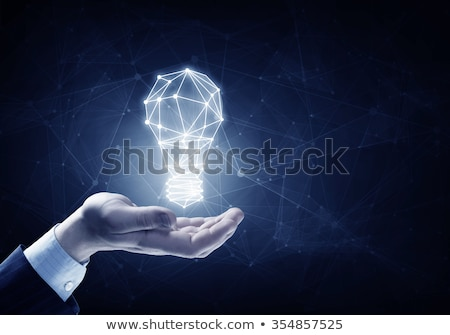 businessman holding illuminated light bulb stock photo © andreypopov