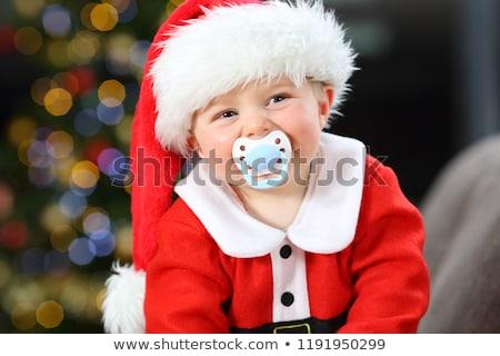 Happy smiling infant baby boy portrait dressed in christmas deer crocheted hat, winter holidays conc Stock photo © galitskaya