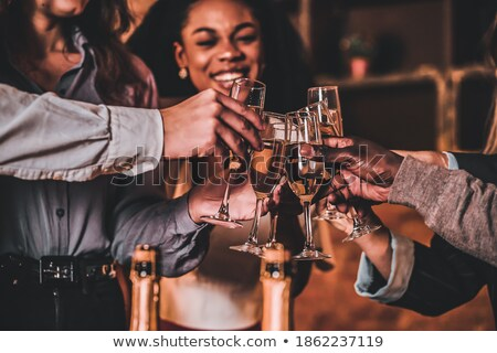friends clinking drinks at home in evening Stock photo © dolgachov