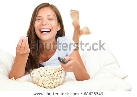 Uśmiechnięty asian kobieta jedzenie popcorn fast food Zdjęcia stock © dolgachov