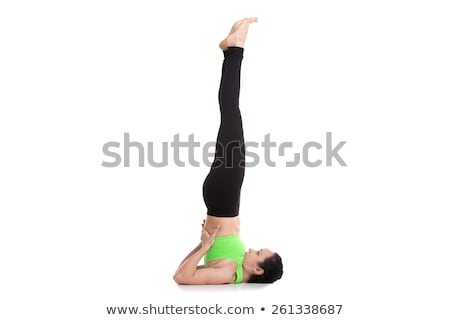 Stock photo: Beautiful young woman doing supported shoulderstand isolated on