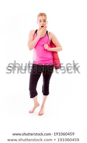 Young woman carrying exercising mat looking shocked Stock photo © bmonteny