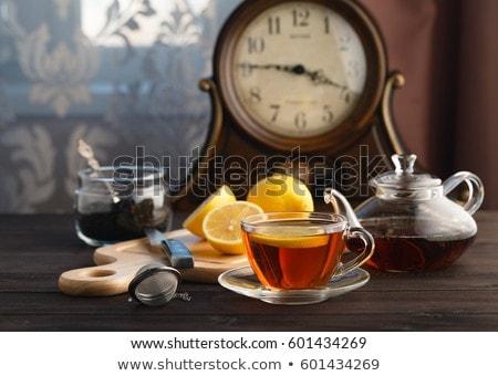 Mug of fresh black tea with lemon Stock photo © ozgur