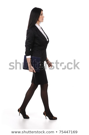 business woman walks on heels with documents in hands, isolated Stock photo © zurijeta